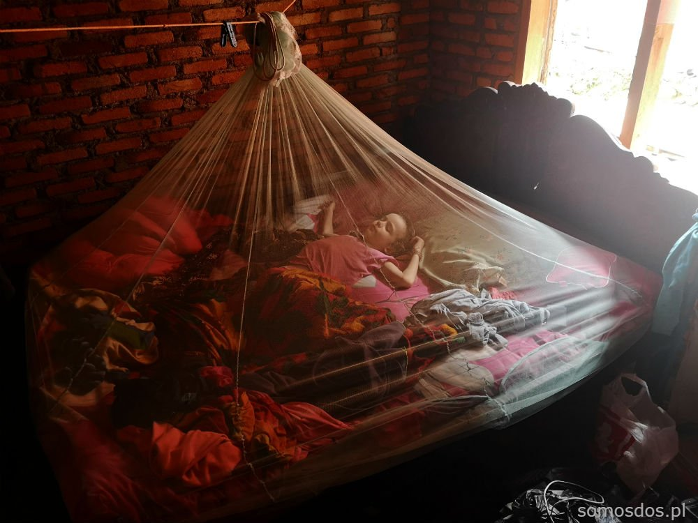 sleeping under mosquito net Sumatra Indonesia